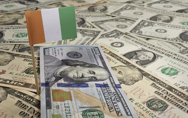 Flag of Ivory Coast sticking in various american banknotes.(seri
