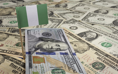 Flag of Nigeria sticking in various american banknotes.(series)