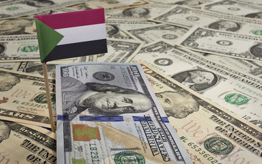 Flag of Sudan sticking in various american banknotes.(series)
