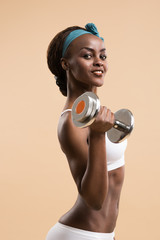 Woman in sport clothes practice with hand weights