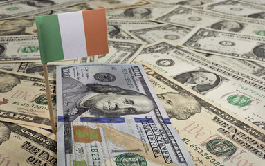 Flag of Ireland sticking in various american banknotes.(series)