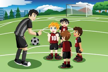 Little kids in soccer field listening to their coach