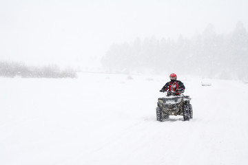 All-terrain vehicle in the snow