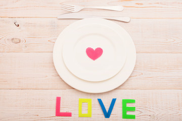 Word love on wooden background. Valentines day.Beautiful