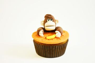 Cupcake with a monkey figure made of fondant