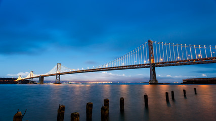 Fotomurales - San Francisco-Oakland Bay Bridge at sunset