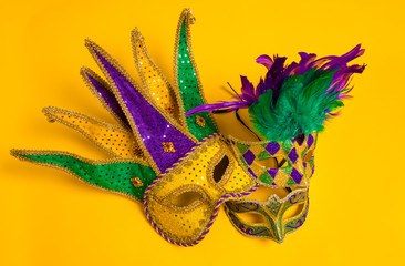 Wall Mural - Mardi Gras Masks on yellow Background