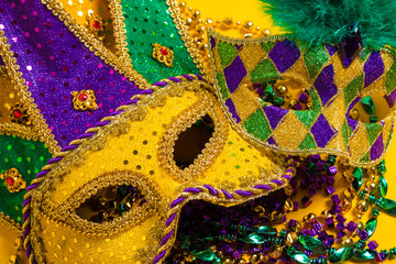 Wall Mural - Group of Mardi Gras Masks on yellow Background wtih beads