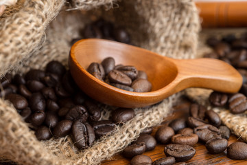 Wall Murals Coffee beans coffee beans in coffee bag made from burlap