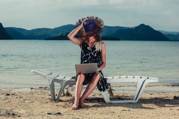 Woman with laptop on beach