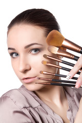 beautiful girl with ideal skin keeps a brush for a make-up