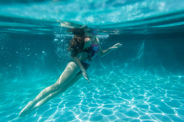 Girl Underwater Surfaces