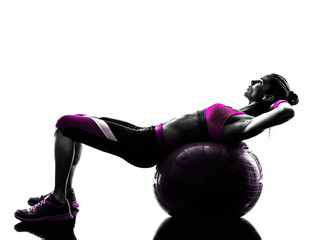 Fototapete - woman fitness ball crunches   exercises silhouette