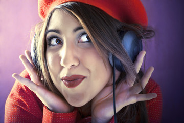 vintage Young woman listening music with headphones