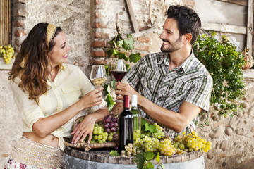 farming couple drinking wine in their old farm