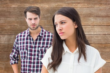Composite image of angry brunette not listening to her boyfriend