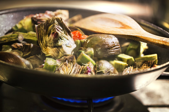 artichokes cooked in a pan