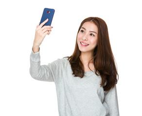 Woman takes selfie