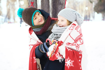 children playing with candy and enjoy the frosty winter