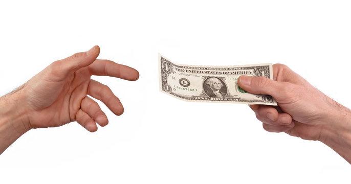 Pagando dinero,mano sujetando billete de un dólar.