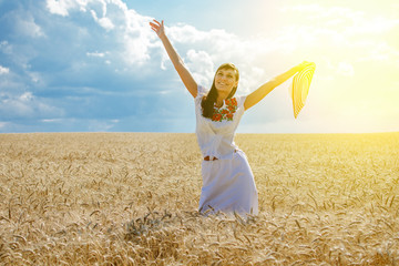 Beautiful rural girl on the wheat field on sunset