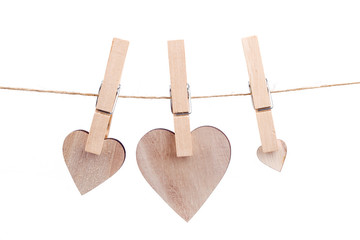wooden heart hanging on the clothesline
