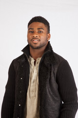 Black man in jacket looking thoughtful