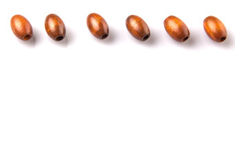 Brown round wooden beads over white background