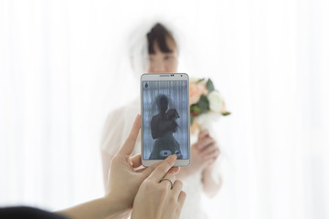 Women who are taking a bride in the smartphone