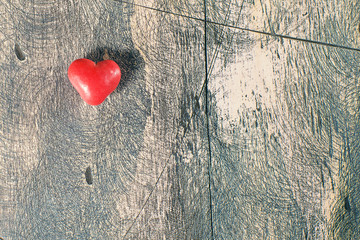 Candy hearts on wooden background