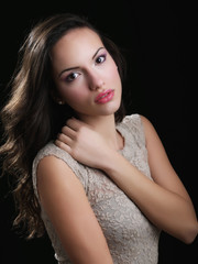 Indoor fashion portrait of beautiful young woman