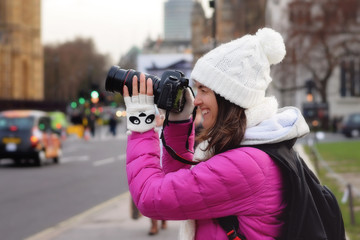 Young woman, taking pictures in London, while traveling on vacat