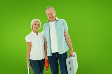 Composite image of happy older couple holding diy tools