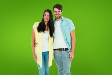 Composite image of happy casual couple smiling at camera
