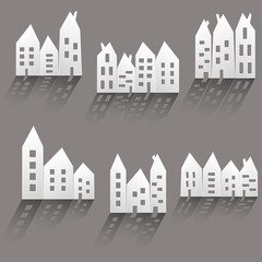 Paper houses with long shadow