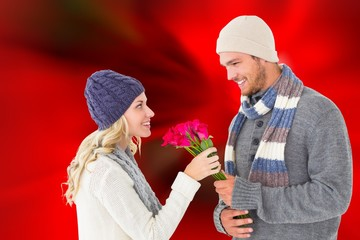 Attractive man in winter fashion offering roses