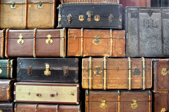 background with large stack of antique suitcases