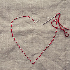 Embroidered heart shape on linen fabric