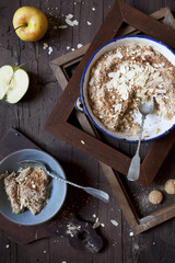 apple crumble with almonds on rustic table with wood frames