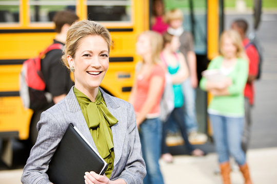 School Bus: Cheerful Teacher By School Bus