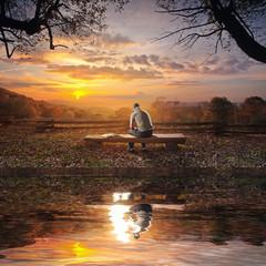 Praying on bench