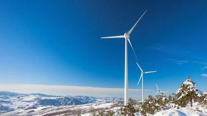 Typical windmill or aerogenerator of aeolian energy on snowy lan