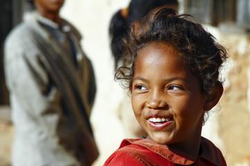 Smiling poor african girl, Madagascar Wall mural