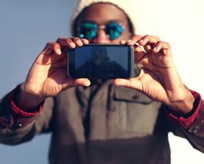 odern stylish african man makes selfie
