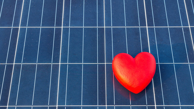 red heart on a solar panel texture