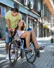 Girl in wheelchair with friend outdoor