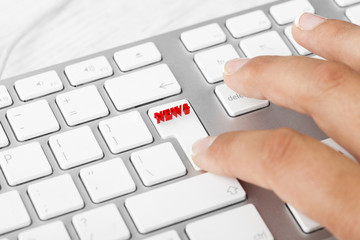 Woman pressing News button