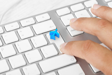 Woman pressing Travel Key On Computer Keyboard