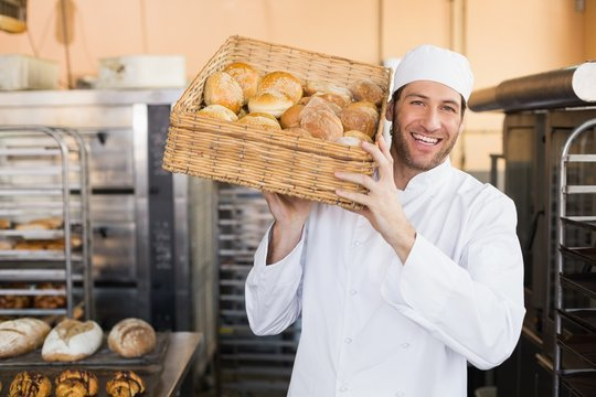 Baker holding basket of bread