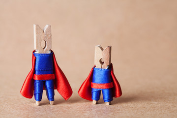 Clothespins. superheroes in blue suit and red cape.